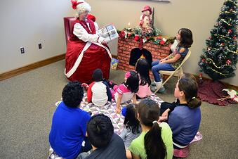 Mrs Claus reading a story